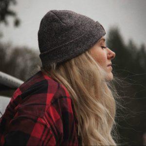 Woman wearing grey beanie