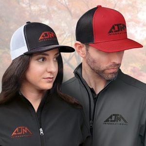 Man and woman wearing baseball caps