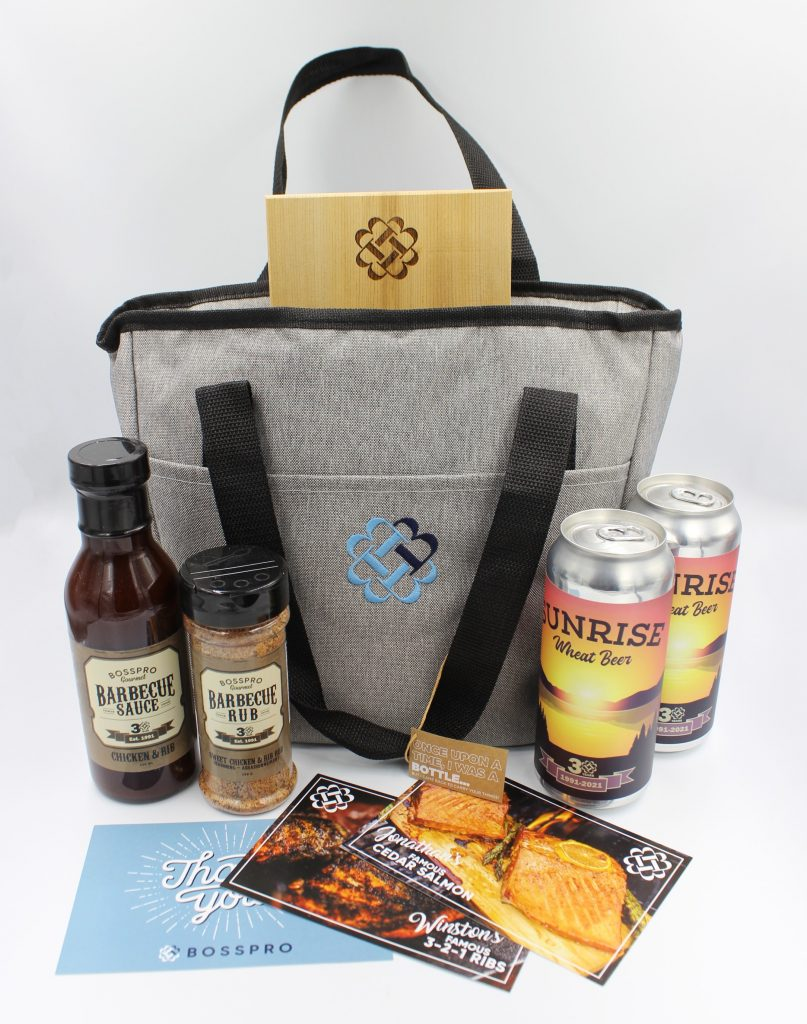 Branded BBQ kit for employees, including BBQ sauce, beer, and recipes
