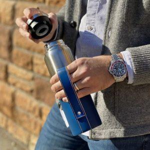 Man holding stainless steel bottle