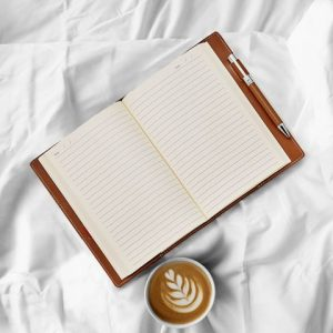 Open journal with coffee