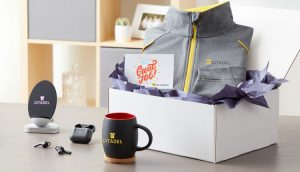 Various promo products, such as zip sweater and mugs