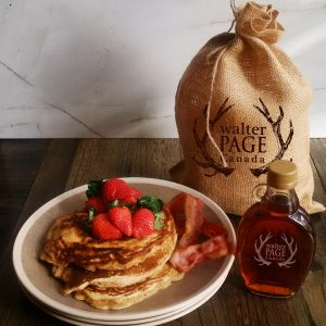 Maple pancakes on plate with berries