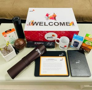 PWC employee welcome kit with branded merch