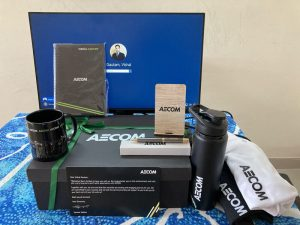 AECOM employee welcome kit with branded merch