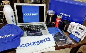 Coursera employee welcome kit with branded merch